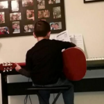 Ryan practicing guitar