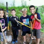 Ryan and friends digging a hole